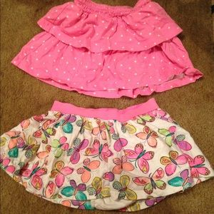 Two pairs of jumping beans skirts with bloomers